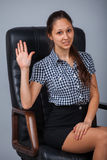 Business woman on a chair Stock Photography