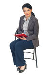 Business woman on chair taking notes stock photography
