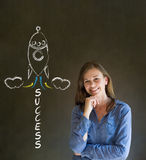 Business woman and chalk success rocket Stock Photo