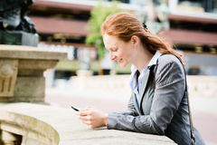 Business Woman Chatting on a Mobile Stock Images
