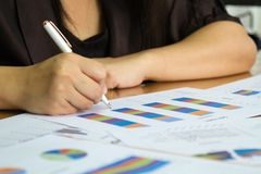 Business woman check business report. Stock Photos