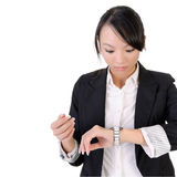 Business woman check time. With surprised expression against white background Royalty Free Stock Photography