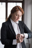 Business woman check time in office Royalty Free Stock Photos