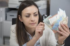 Business woman checking the authenticity of money Stock Photography