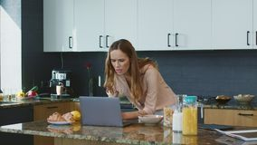 Business woman checking email. Concentrated person looking at laptop computer. Business woman checking email in luxury house. Concentrated female person looking stock footage