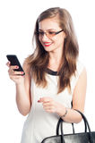 Business woman checking her smartphone. Isolated on white background Stock Photos