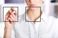 Business woman checking mark on checklist. Rbusiness woman checking mark on checklist with a red marker Stock Images