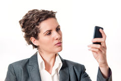 Business woman checking mobile phone Royalty Free Stock Images