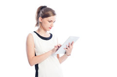Business woman checking a tablet Royalty Free Stock Photos