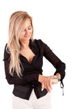 Business woman checking time Royalty Free Stock Images