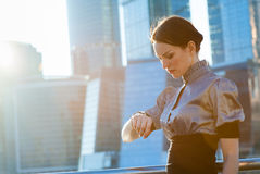 Business woman checking the time Stock Images