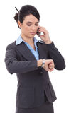 Business woman checking time on phone Stock Image