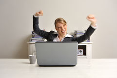 Business woman cheering. Deal is a fact / Reached goals, Photographic movement in the hands and arms reinforce this pose Stock Images