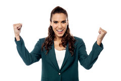 Business woman cheering with her arms raised Stock Images
