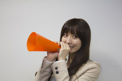 Business woman cheering with megaphone Royalty Free Stock Image