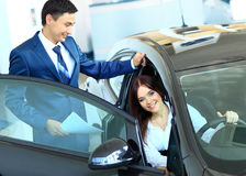Business woman chooses a car in the office Stock Photography