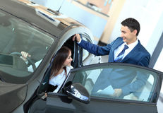Business woman chooses a car in the office Royalty Free Stock Photo