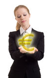 Business woman chooses golden euro sign Royalty Free Stock Image
