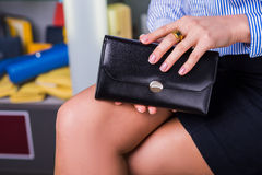 Business woman chooses wallet. Shop accessories. Shopping concept. Business woman chooses wallet. Shop accessories. Closeup beautiful hand, holding handbag Stock Photos