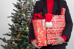 Business woman with christmas presents Royalty Free Stock Photos