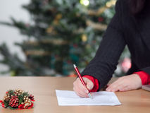 Business woman with christmas wish list Stock Image