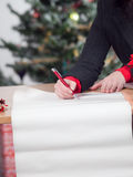 Business woman with christmas wish list 2 Stock Photography