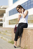 Business woman in the city. Woman enjoying coffee outside the office building Stock Image