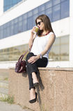 Business woman in the city. Woman enjoying coffee outside the office building Stock Images