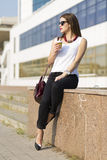 Business woman in the city. Woman enjoying coffee outside the office building Royalty Free Stock Images