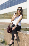 Business woman in the city. Woman enjoying coffee outside the office building Royalty Free Stock Photography