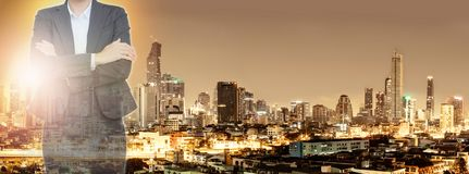 Business woman and city at night background. Concept Business never stops Stock Image