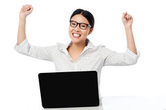 Business woman clenching fists in excitement. Excited pretty businesswoman with clenched fists over white background Stock Images