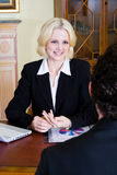 Business woman and client. Business woman talking to her client in office Royalty Free Stock Photography