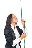 Business woman climb rope and looking up Royalty Free Stock Image
