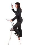 Business woman climbing ladder Stock Photo