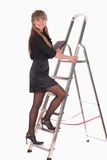 Business woman climbing ladder Royalty Free Stock Photos