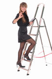 Business woman climbing ladder Stock Image