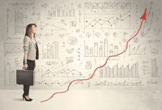 Business woman climbing on red graph arrow concept Stock Images