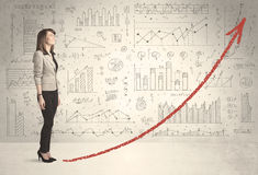 Business woman climbing on red graph arrow concept Stock Photo