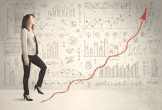 Business woman climbing on red graph arrow concept Royalty Free Stock Images