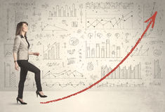 Business woman climbing on red graph arrow concept Stock Photography