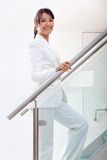 Business woman climbing stairs Royalty Free Stock Photo