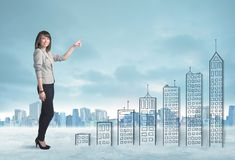 Business woman climbing up on hand drawn buildings in city Royalty Free Stock Photo