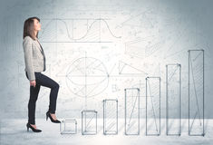 Business woman climbing up on hand drawn graphs concept. On background Stock Photo