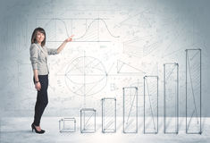 Business woman climbing up on hand drawn graphs concept Stock Photos