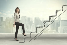 Business woman climbing up on hand drawn staircase concept Royalty Free Stock Photo