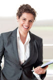 Business woman with clip board in hand and smiling Stock Photos