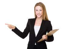 Business woman with clipboard and finger up Royalty Free Stock Images