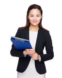 Business woman with clipboard and laptop computer Stock Photo