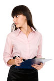 Business woman with a clipboard looking away Royalty Free Stock Photography